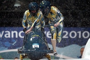 Cool runnings ... Astrid Loch-Wilkinson, right, and Cecilia McIntosh start their run during a women's bobsleigh heat at the Vancouver 2010 Winter Olympics. Photo: Issei Kato
